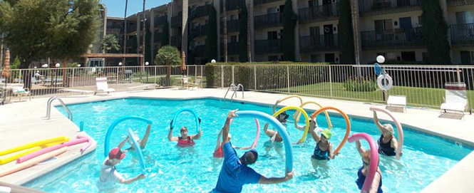 Independent living fitness groups active in the pool