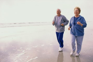 Elderly man and woman on the beach