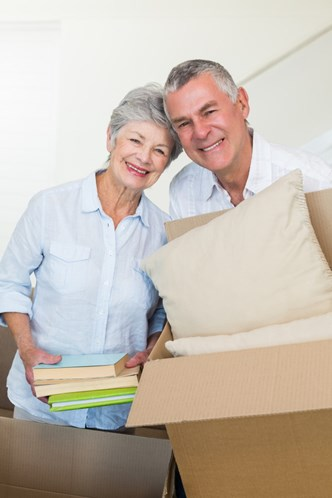 Elderly couple packing boxes