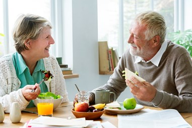 Elderly couple eating