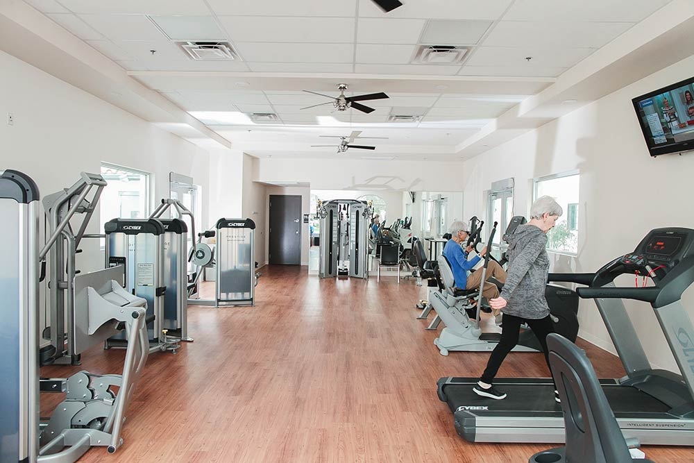 Seniors exercising in fitness center at Fellowship Square