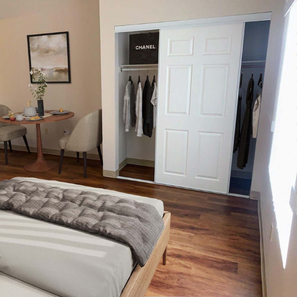 Photo of bedroom & closet in assisted living studio for seniors